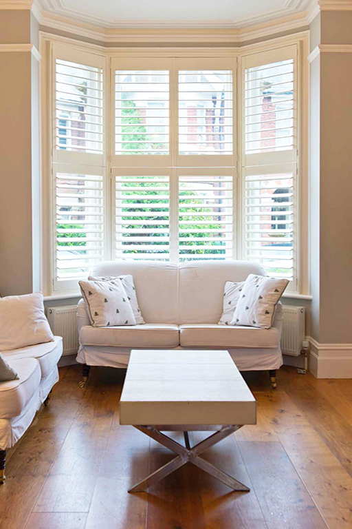 Photo gallery plantation shutters window shutters - Living room bay window treatments ...