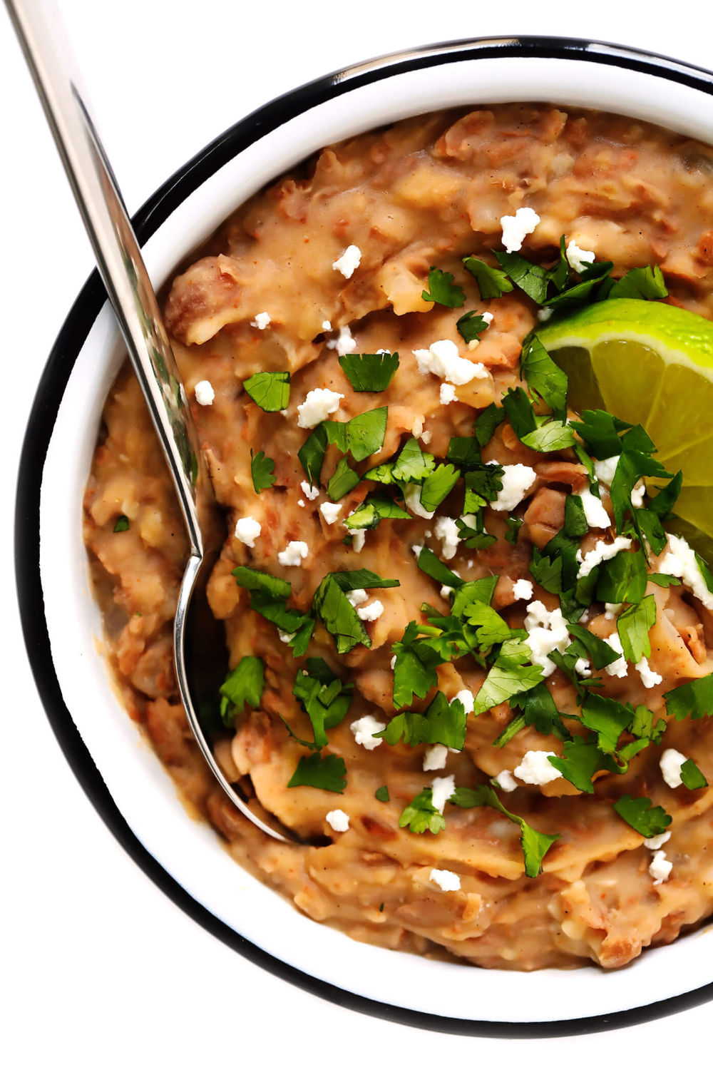 This homemade refried beans recipe is easy to make in about 20 minutes with vegetarian ingredients you can feel great about! It's the perfect easy Mexican side dish, or can be added to tacos, burritos, enchiladas and more. Or just serve with tortilla chips as an easy dip! | gimmesomeoven.com #refriedbeans #mexican #dip #side #glutenfree #vegetarian #vegan #healthy #cincodemayo