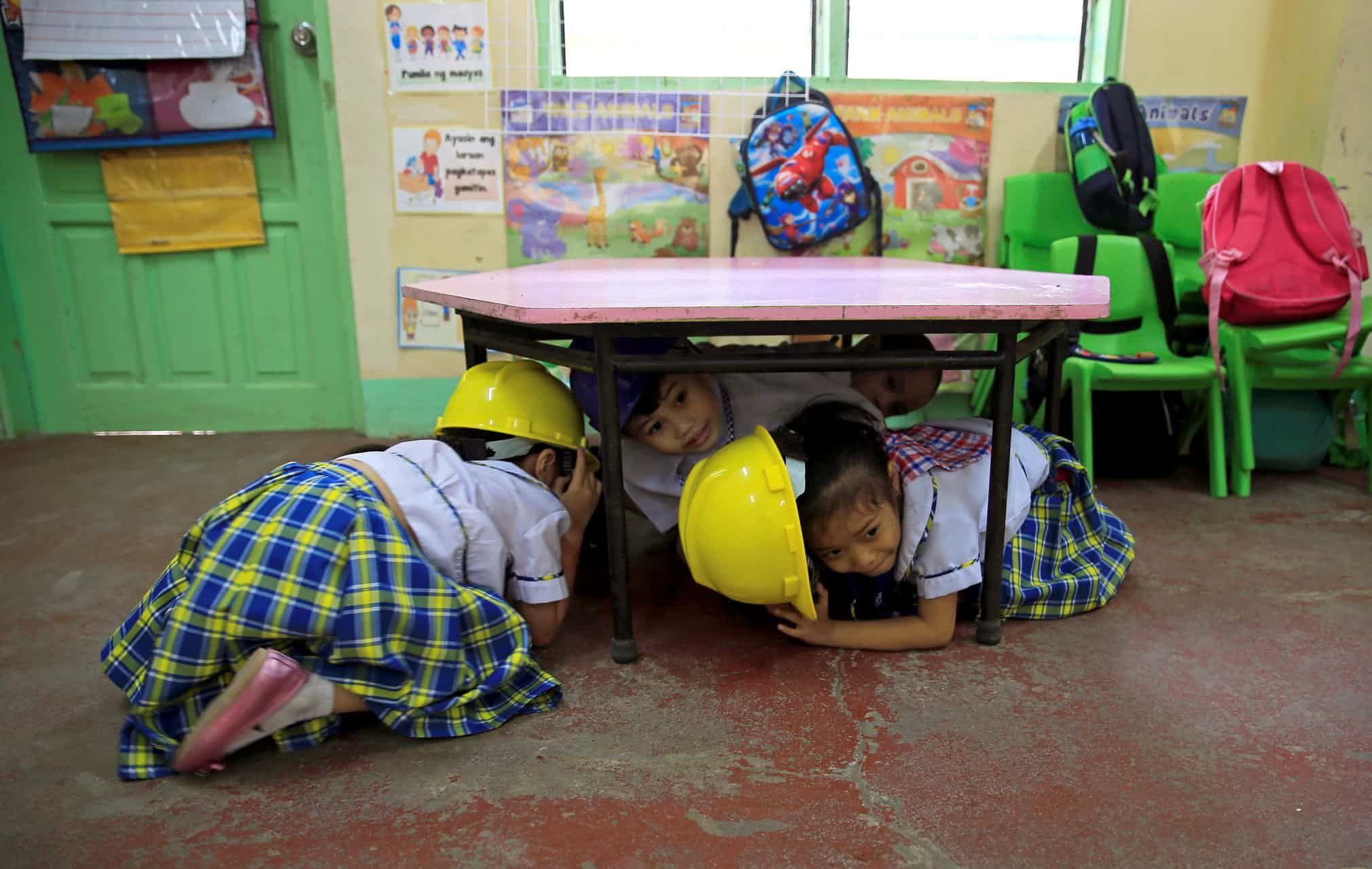 Manila Philippines Students Hide Under A Desk During An Earthquake Drill At An Elementary School In Paranaque Photograph Romeo Ra Cute Kids Philippines Kids