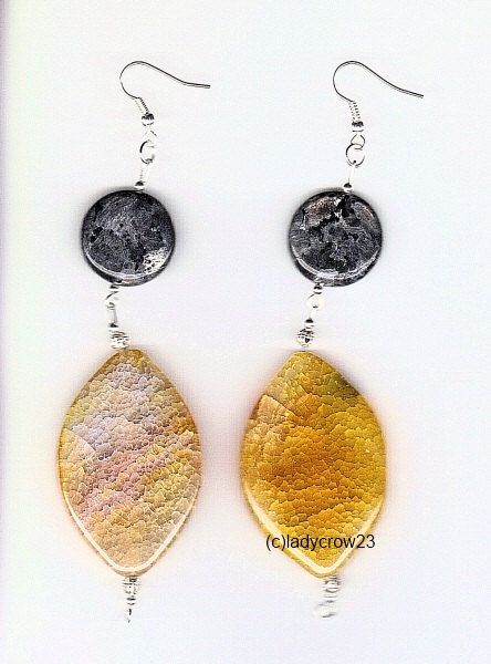 Proceeds benefit animals! Dangle earrings with Larvikite and Crackled Yellow Agate. $15.00, via Etsy.