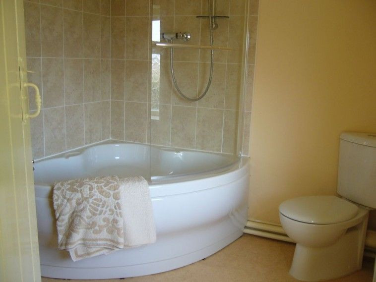 Bathroom White Curved Bathroom Corner Tub With Shower Having