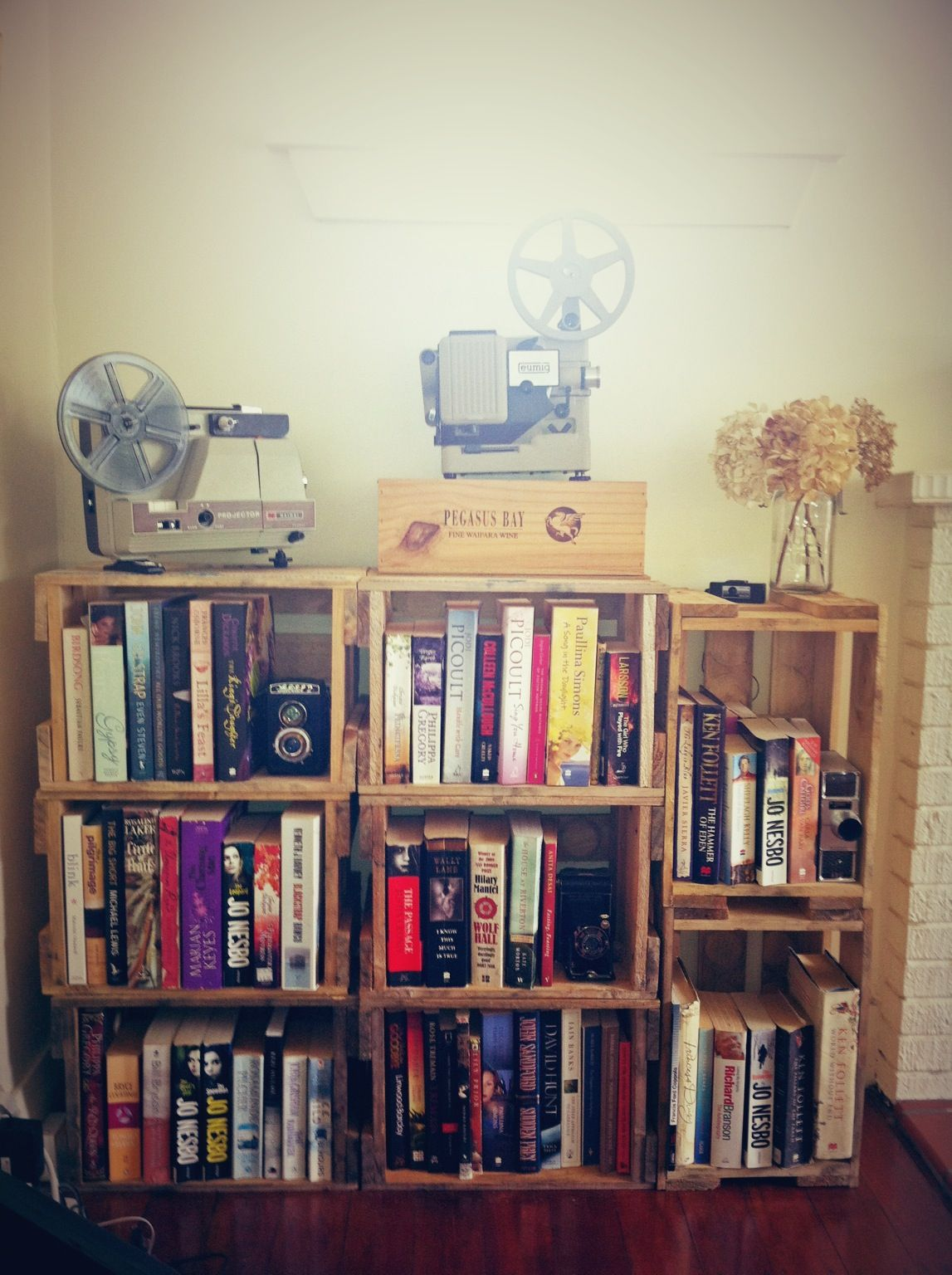 Crate bookshelf with vintage cameras