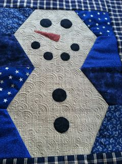 """Quilts and Such made this adorable snowman using a pattern from Quilting Deals - Missouri Star Quilt Co and quilted with Aurifil 50wt thread.  """"Once stitching was done close to the edge of each appliqué piece, the snowman was quilted with swirls with white 50 weight #Aurifil thread and surrounded in the blue by freehand lines in a lighter blue thread.""""  To read more please visit http://pennyquilt.blogspot.com/2015/12/mr-snowman-and-christmas-finishes.html"""