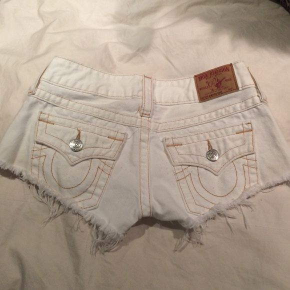 White True Religion shorts Really cute white shorts from True Religion. I wore them one time. Not a fan of white shorts anymore but they will look really good on you! Perfect for the summer time. I usually wear a size 24-25 but these shorts run small so I got a 26! True Religion Shorts