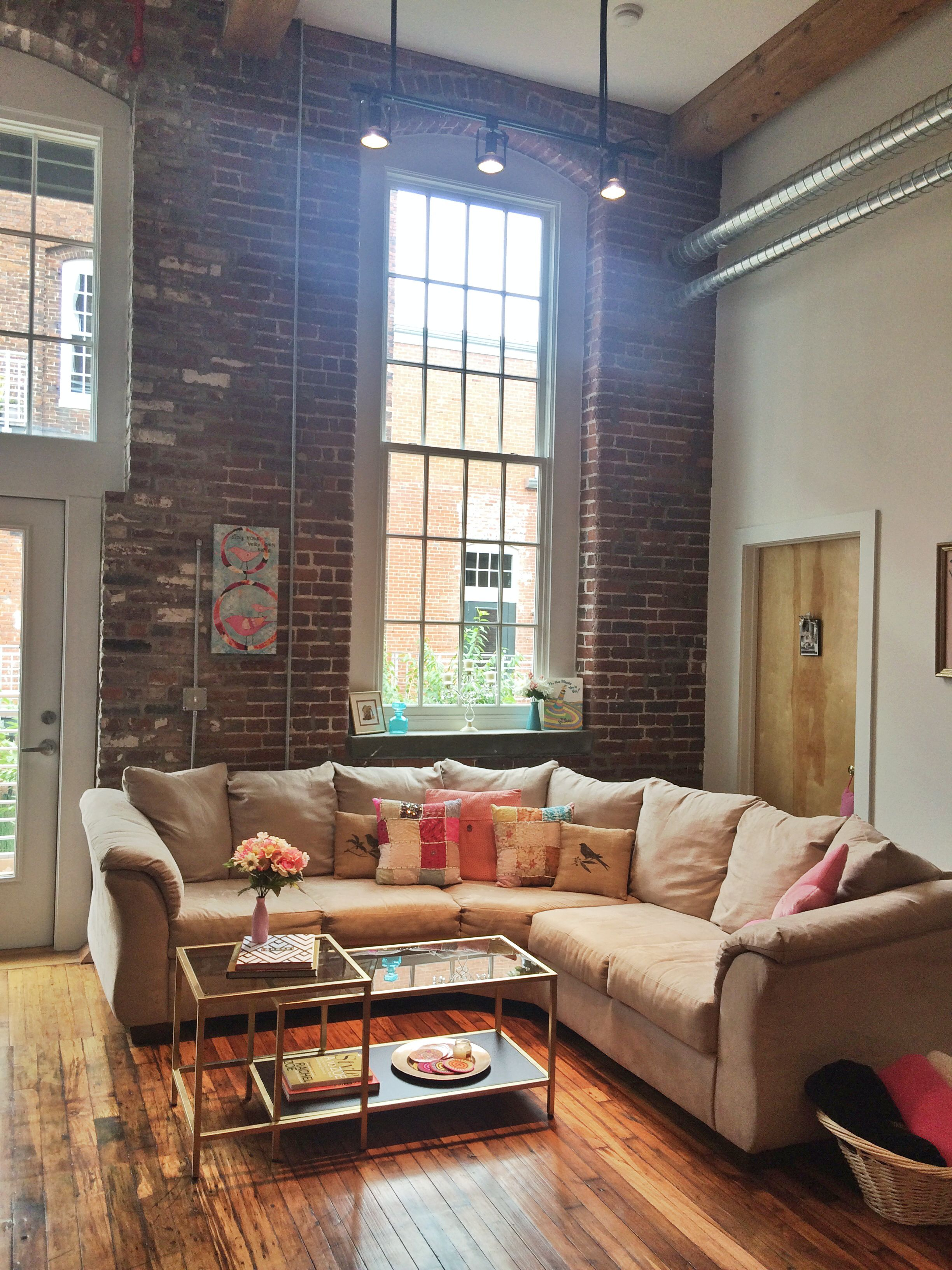 Exposed Brick, High Ceilings, And The Perfect Gold And Glass