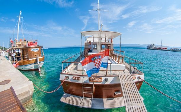 Brač, Dol, Croatia — by Jelle Canipel. #TroveOn - a skipper relaxing on his boat. The athmosphere on the croatian Islands is fantastic! Crystal clear sea,...
