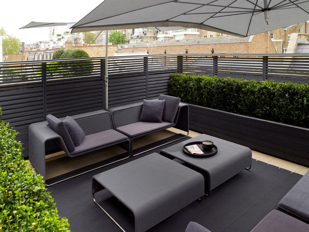 Contemporary outdoor furniture on an outdoor terrace pinned to garden design outdoor furniture by darin bradbury