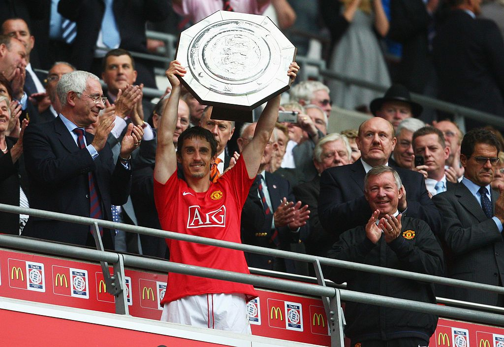 London August 10 Gary Neville Of Manchester United Lifts The Trophy As They Are Victorious On Penalty Kicks Manchester United Community Shield Man Utd News