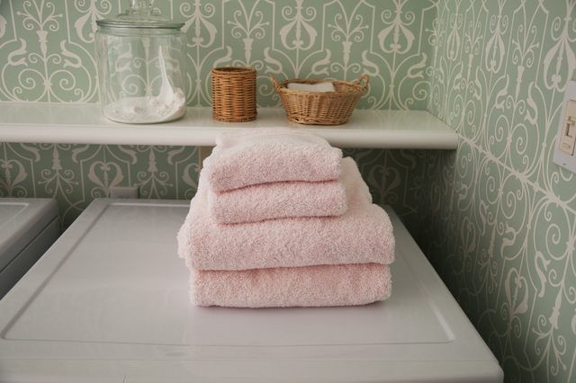 Even the most expensive of towels can become stiff and lose their absorbency over time. The main culprit is fabric softeners. These coat the fibers of the towel with each wash until they repel moisture and each little fiber is stiff and scratchy. Once they begin to repel moisture, it can be more difficult to get them clean. This can cause them to...