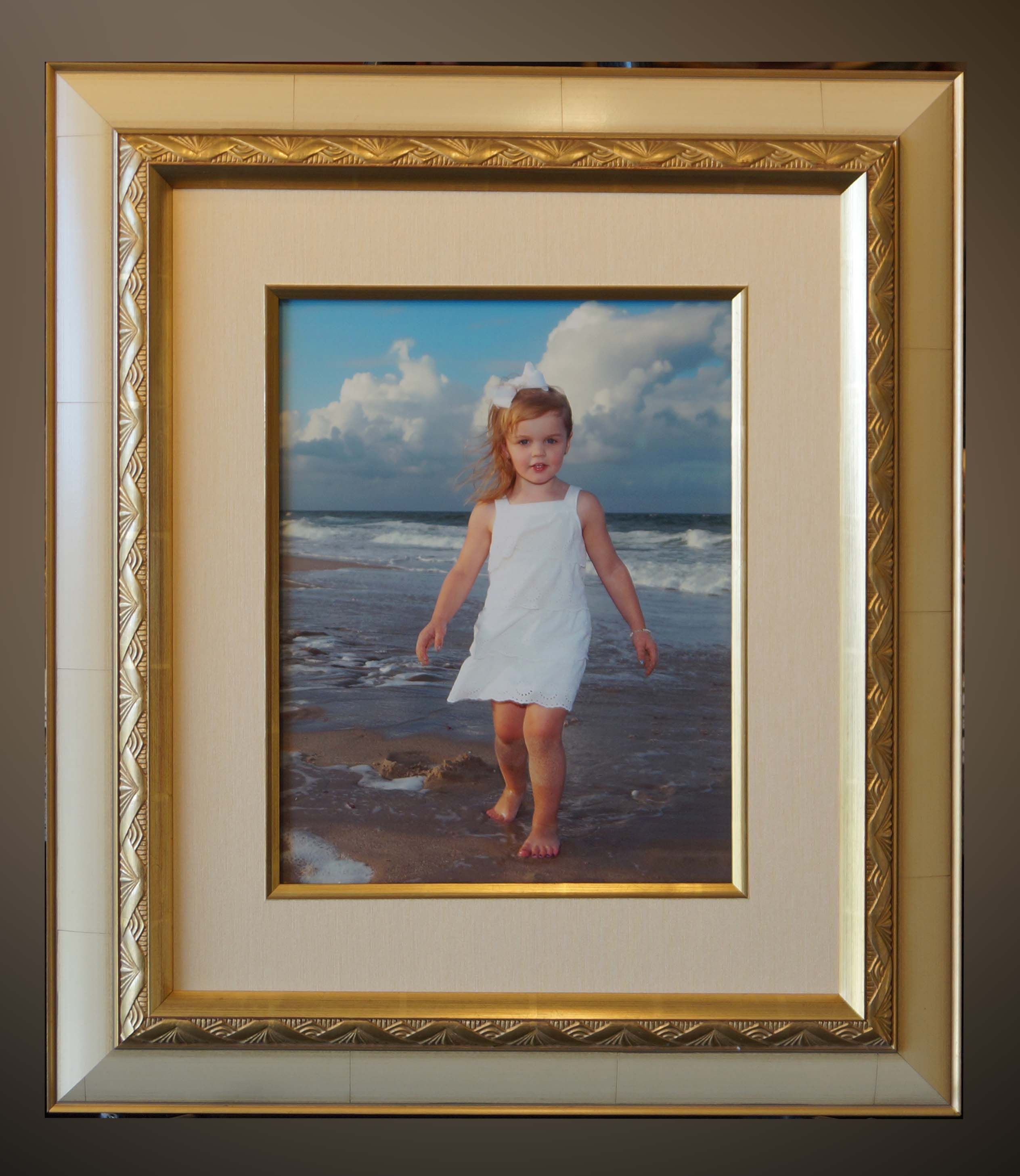 A Beautiful Gold Accented Frame With Art Deco Details And Matching