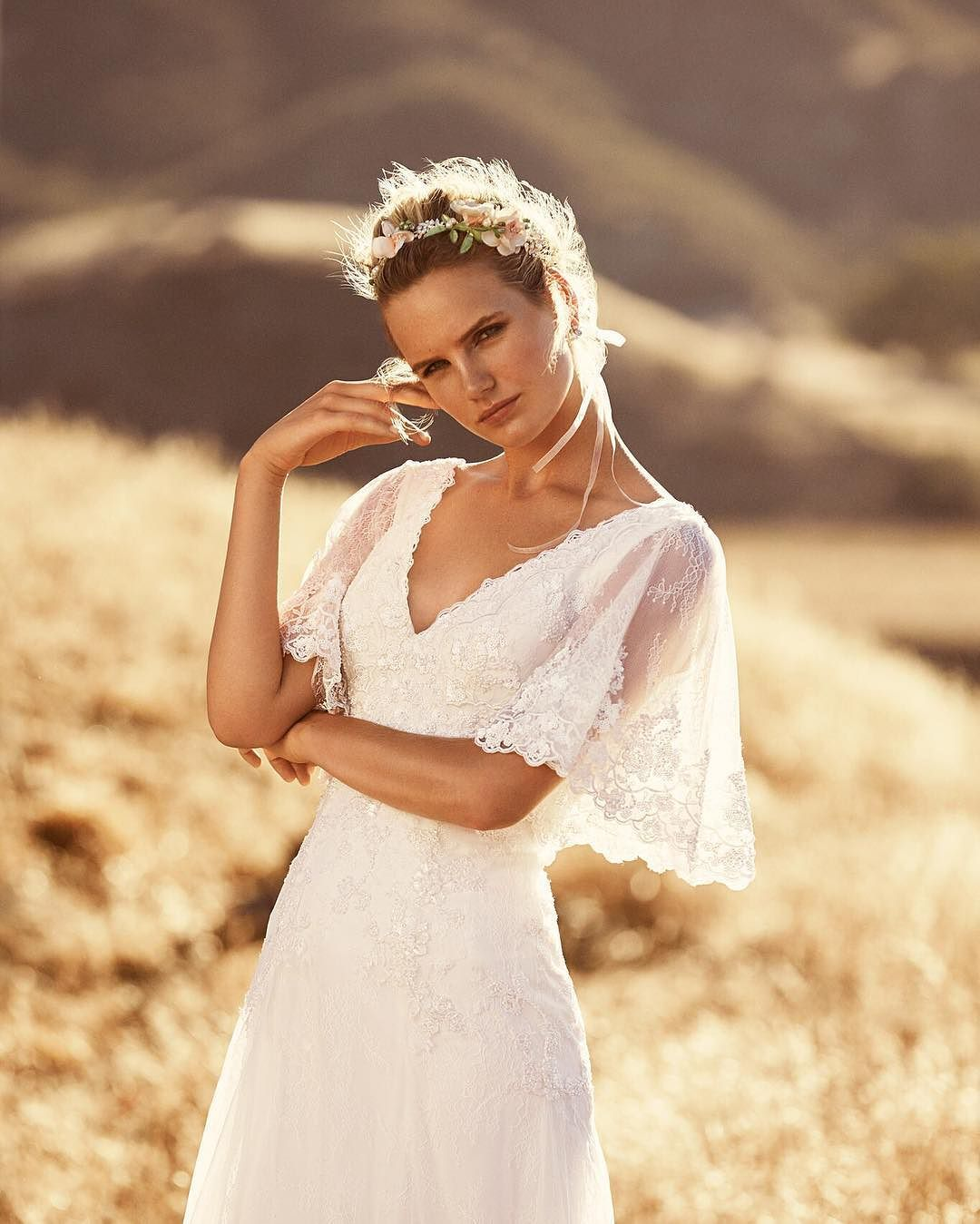 Beaded lace flutter sleeves make this romantic gown look like a ...