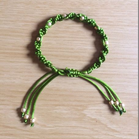 Green satin cord spiral macrame bracelet with gold beads