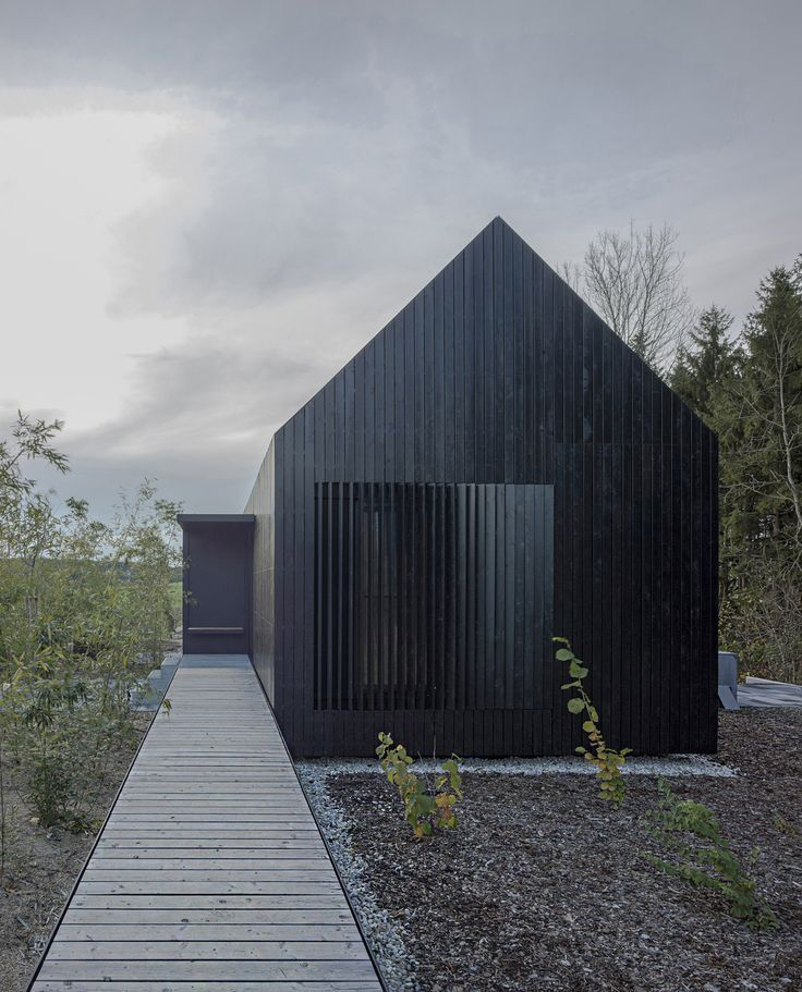 Photo of format elf nestles dark barn-shaped houses into bavarian forest