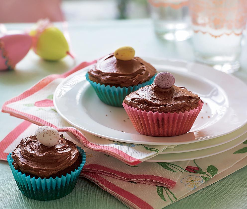 3 chocolate fairy cakes with chocolate icing and topped with a chocolate mini egg