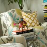 Arches Print pillow and unknown floral on chair (it reminds me of Josef Frank)