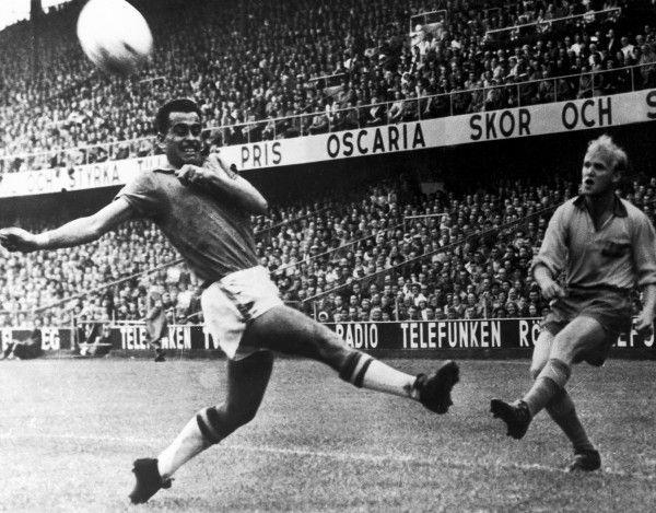 Sweden winger Lennart 'Nacka' Skoglund (right) crosses the ...