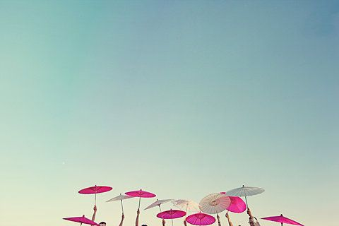 parasols in color against the sky