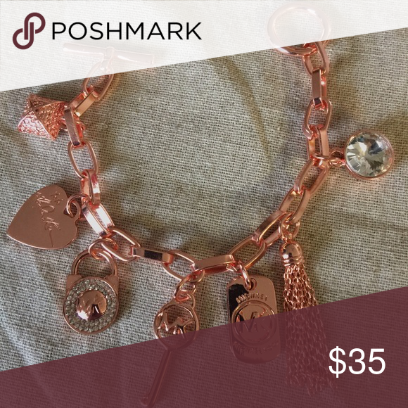 MK Rose Gold Bracelet with Charms Link Bracelet MK Rose Gold Bracelet KORS Michael Kors Jewelry Bracelets