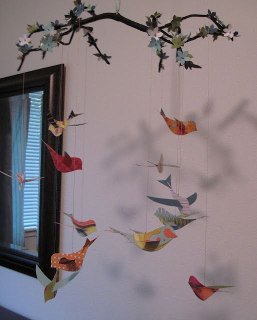 Polly Want A Crafter?: Beautiful DIY Flowering Branch and Bird Nursery Mobile.  For later.