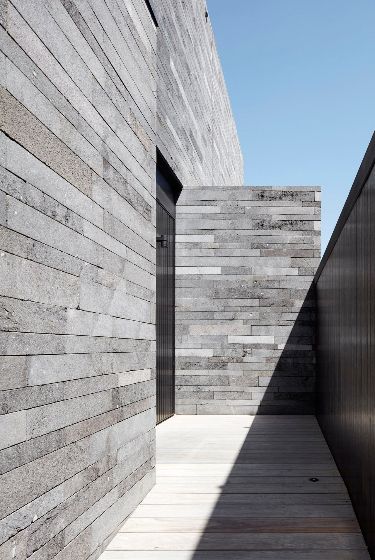A Residence Clad In Rough Lava Stone Stone Cladding
