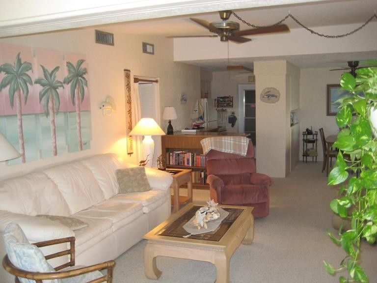 I love the palm trees over the sofa. Private Homes Vacation Rental ...
