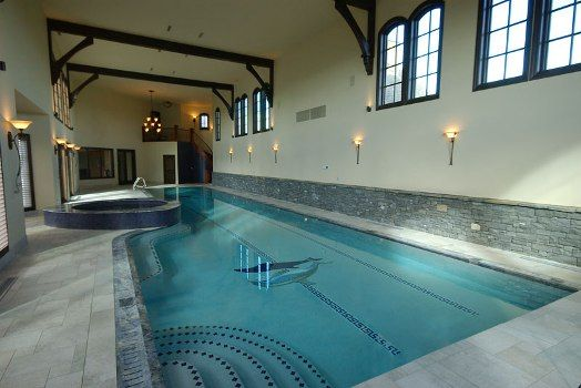 This indoor lap pool and attached spa illustrate how the for Indoor pool designs