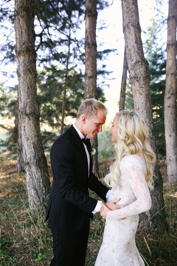 Modest wedding dress with long lace sleeves and a flowing