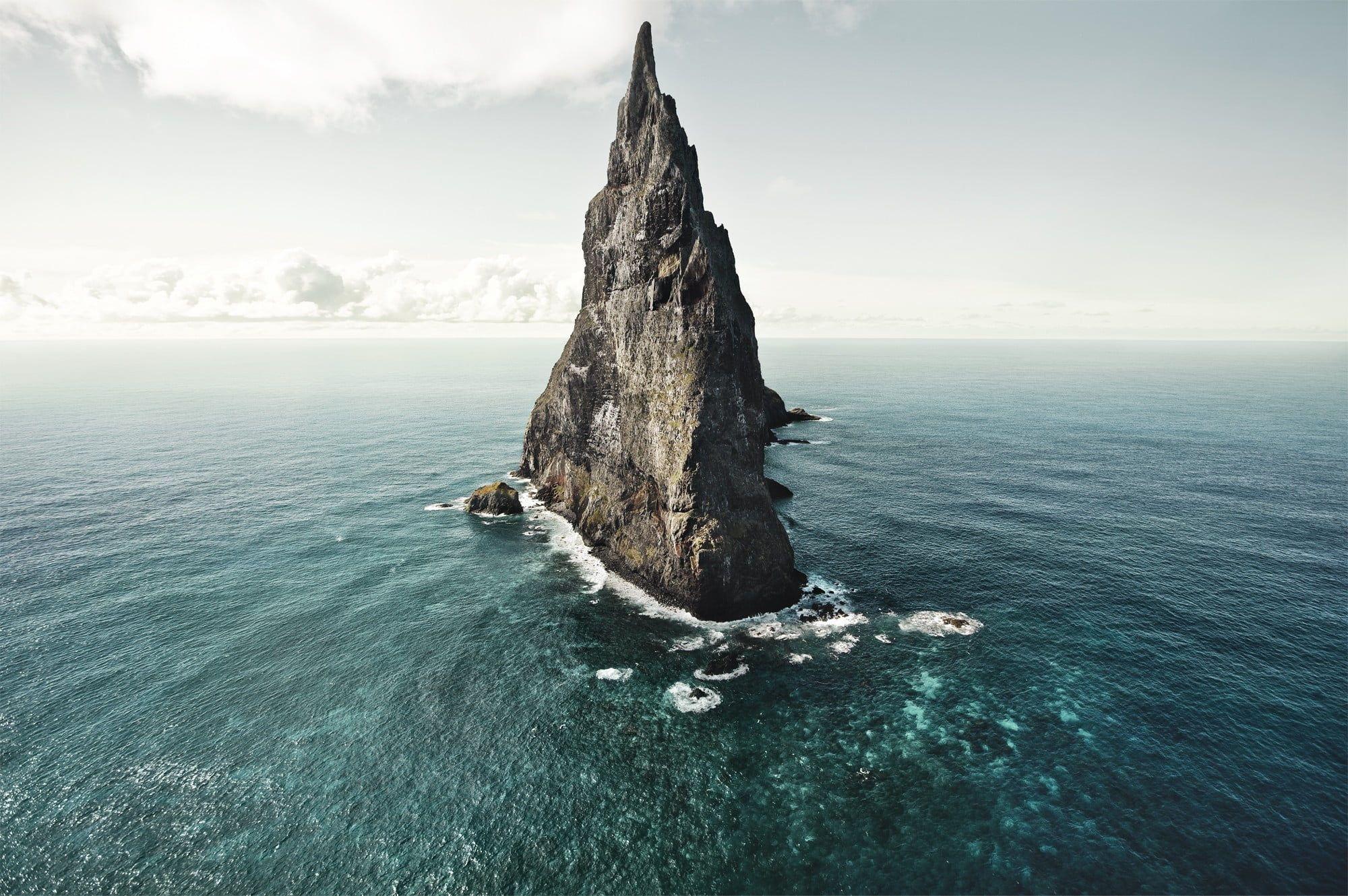 Stone Spire On Water Digital Wallpaper Gray Rock Formation On