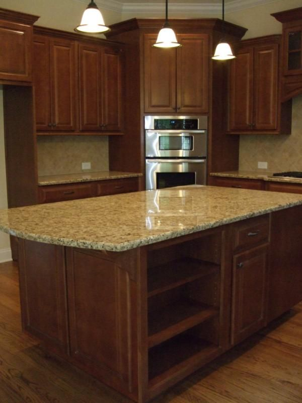 new home kitchen design ideas. This granite and backsplash would match perfectly with the wood cabinets  floors Looks like santa cecelia Kitchen Islands New Home Ideas Trends trends