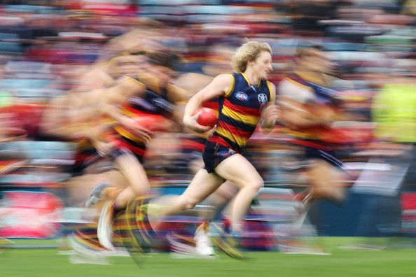 Rory Sloane of the Crows runs with the ball.fore the round 22 AFL match between the Adelaide Crows and the Melbourne Demons at AAMI Stadium on August 24, 2013 in Adelaide, Australia.