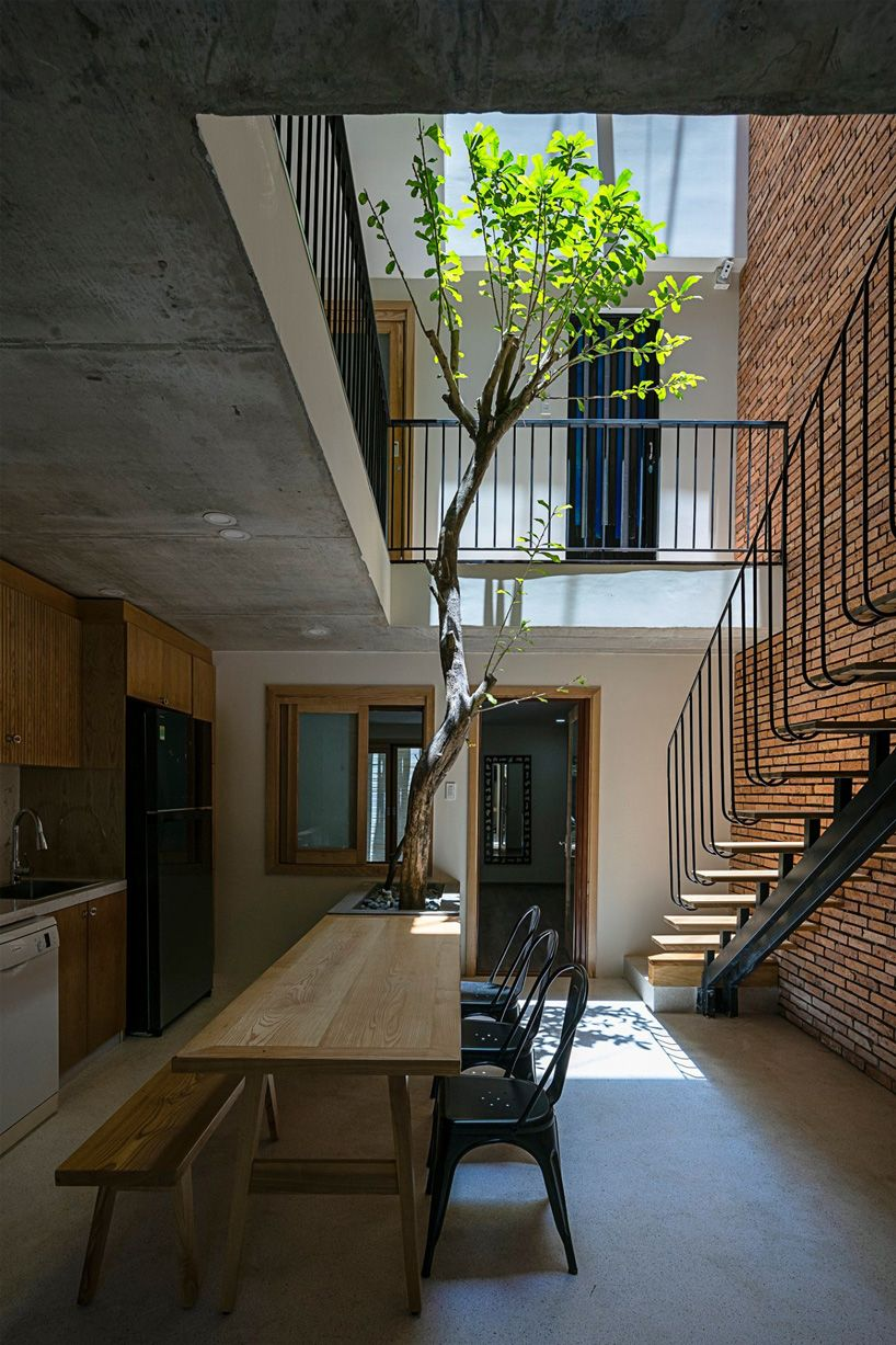 IZ architects completes vietnamese house with front courtyard enclosed by steel grid