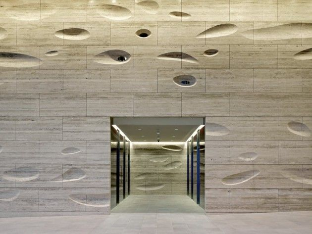 This sculpted travertine wall is located inside the 20 Gresham Street building in London, designed by Kohn Pedersen Fox.