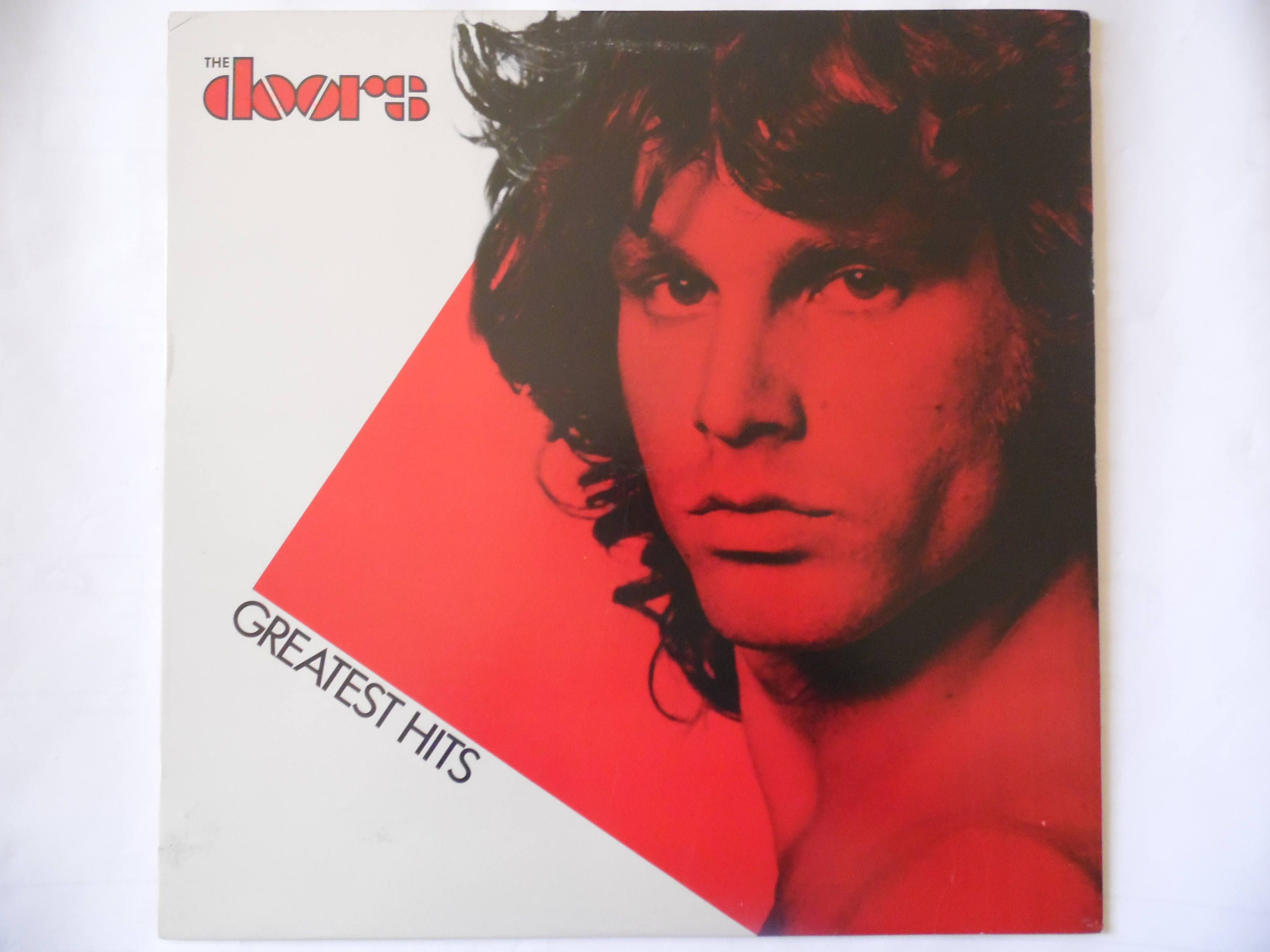 The Doors, Greatest Hits vinyl record with picture sleeve and lyrics insert  by theposterposter on