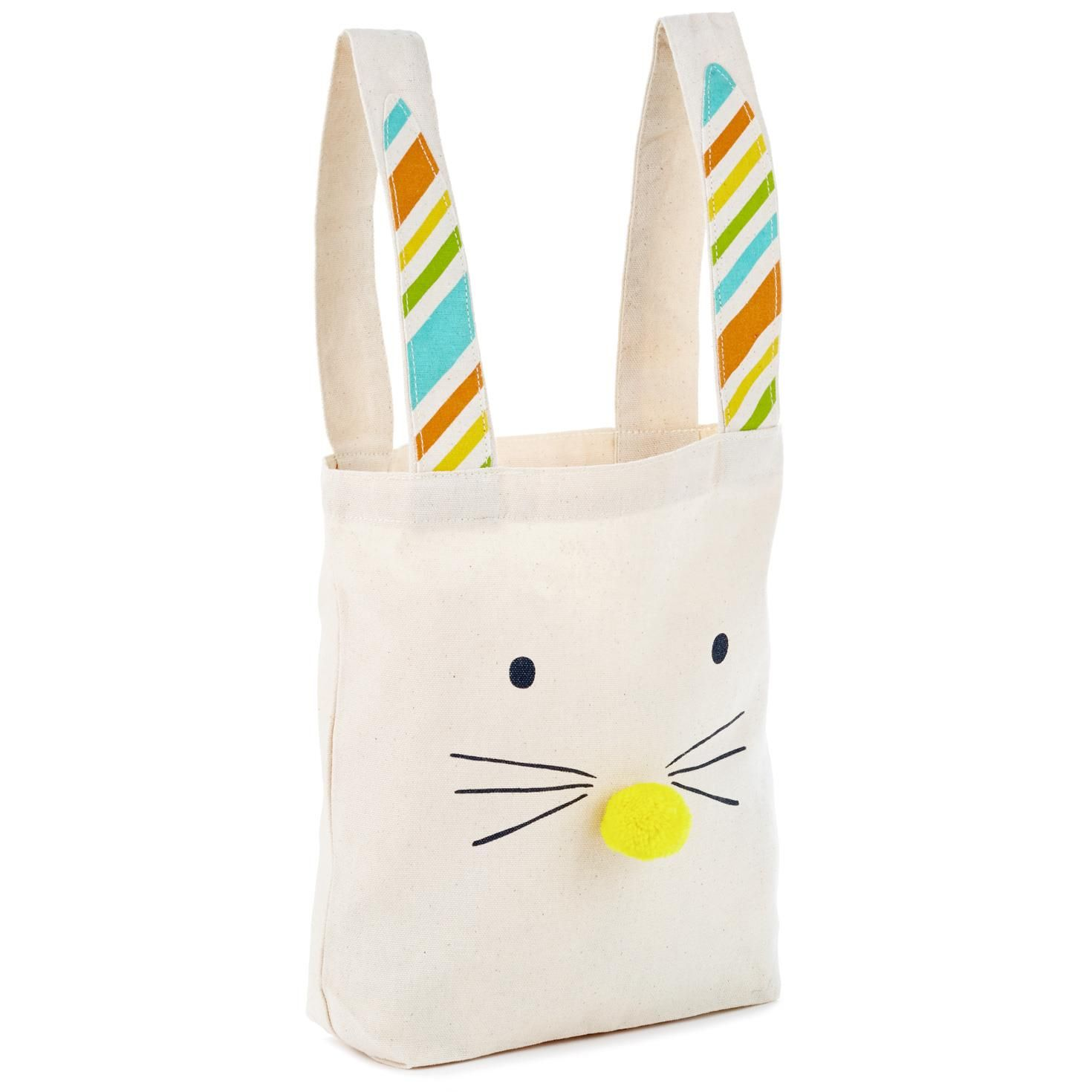 Fill this cute canvas bag with Easter treats—or take it along on your Easter egg hunts! Tote bag features a printed Easter Bunny design with fabric-lined ear handles and pom pom nose. Use this reusable fabric gift bag as a fun Easter basket alternative, or fill with spring-scented candles, printed tea towels or seasonal decor to create an Easter party hostess gift that's sure to be appreciated.