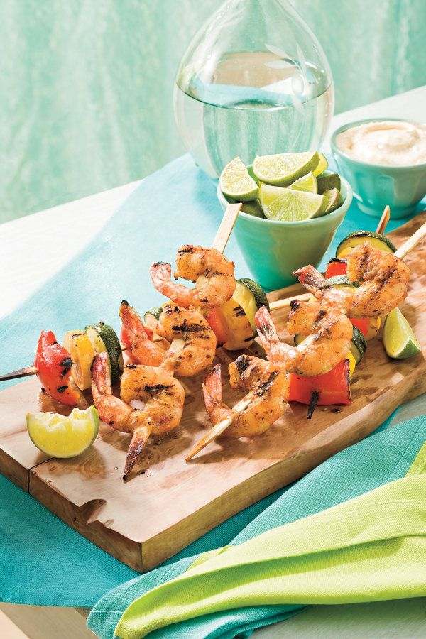 the sweet and tangy shrimp and seasoned vegetables are a complete meal on a stick