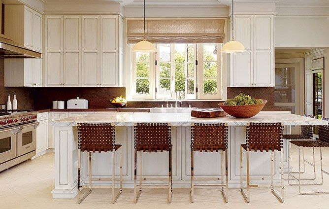 The kitchen is designed for serious entertaining, with Mark Albrecht leather counter stools and a Wolf range.
