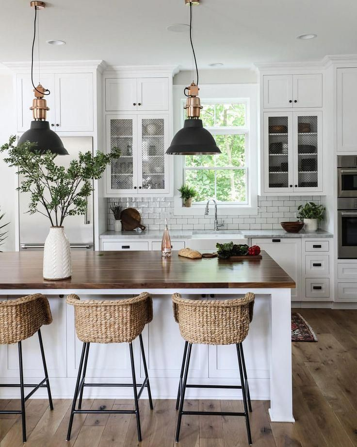 White Kitchen With White Subway Tile And Wood Island
