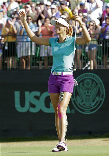 Michelle Wie reacts after winning the U.S. Women's Open golf tournament in Pinehurst, N.C., Sunday, June 22, 2014. (AP Photo/Bob Leverone) ▼19-22Jun2014AP LPGA TOUR 6/19/2014-6/22/2014 http://bigstory.ap.org/photo-gallery/lpga-tour-6192014-6222014 #US_Womens_Open_Championship_2014 #Michelle_Wie