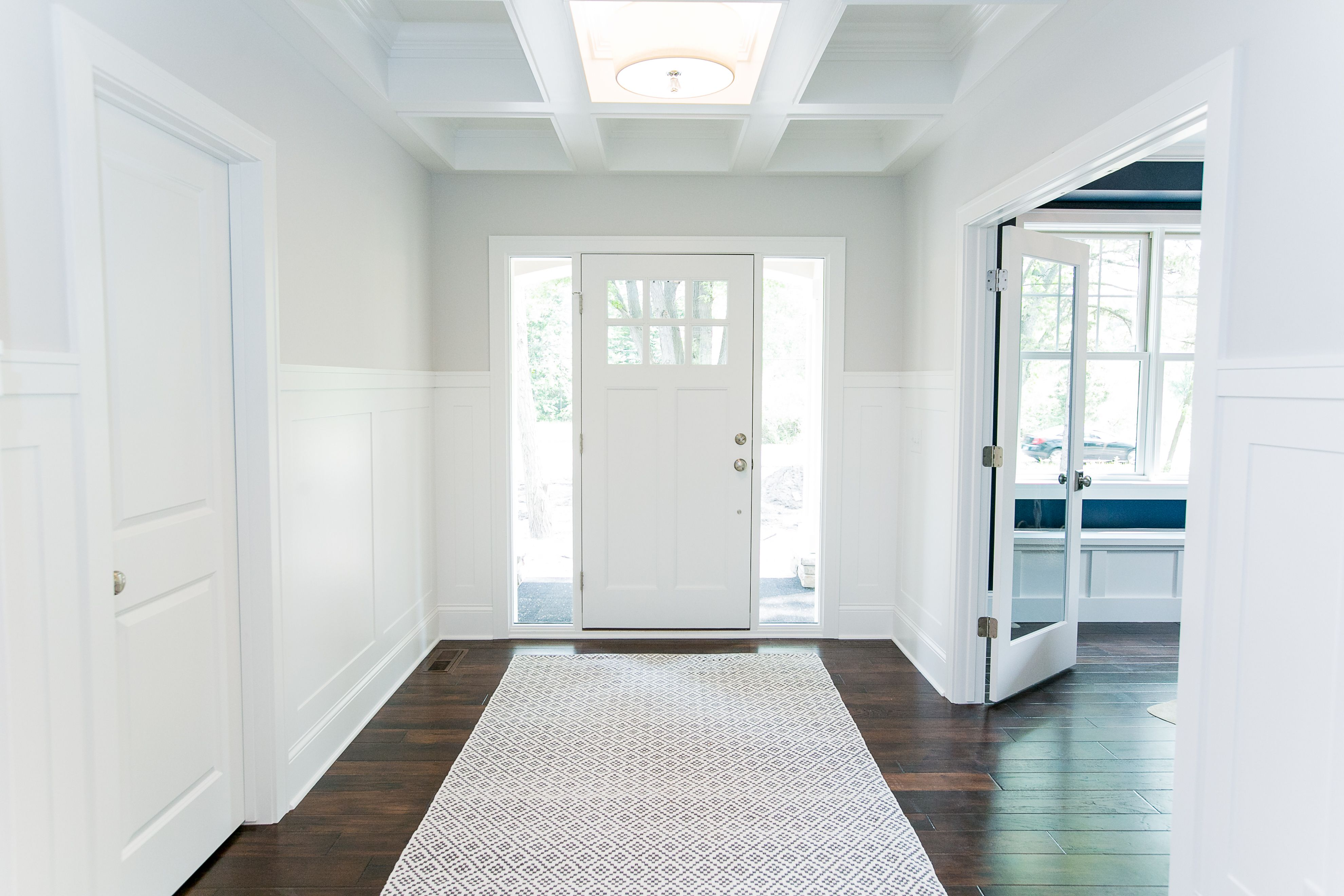 Custom home by SD Custom Homes. Entryway with coffered ceiling and ...