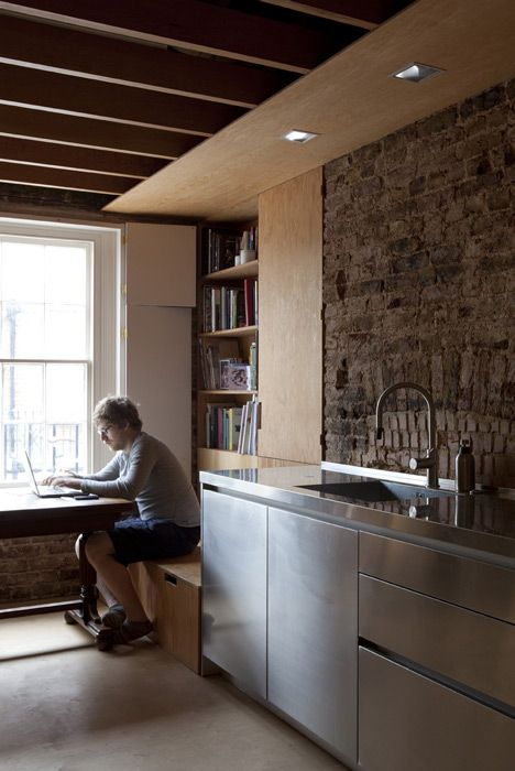 Frame House By Jonathan Tuckey Design Plywood Kitchen Stainless Steel Stone Dining Built In Bench Books Shelves
