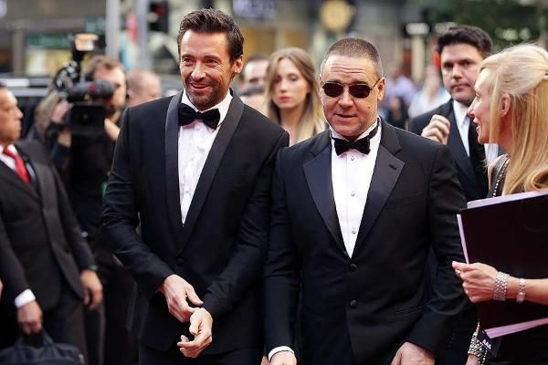 SYDNEY, AUSTRALIA - DECEMBER 21: Hugh Jackman and Russell Crowe walk the red carpet during the Australian premiere of 'Les Miserables' at the State Theatre on December 21, 2012 in Sydney, Australia. Jackman was nominated Thursday for an Academy Award for Best Actor in a Leading Role.