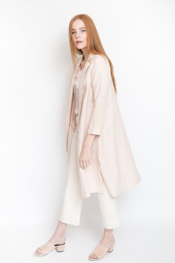 Ali Golden Linen Notch Jacket in blush pink. Linen/cotton notch collar jacket with side-seam pockets, side slits and option to roll sleeves. Hem hits mid-cal...