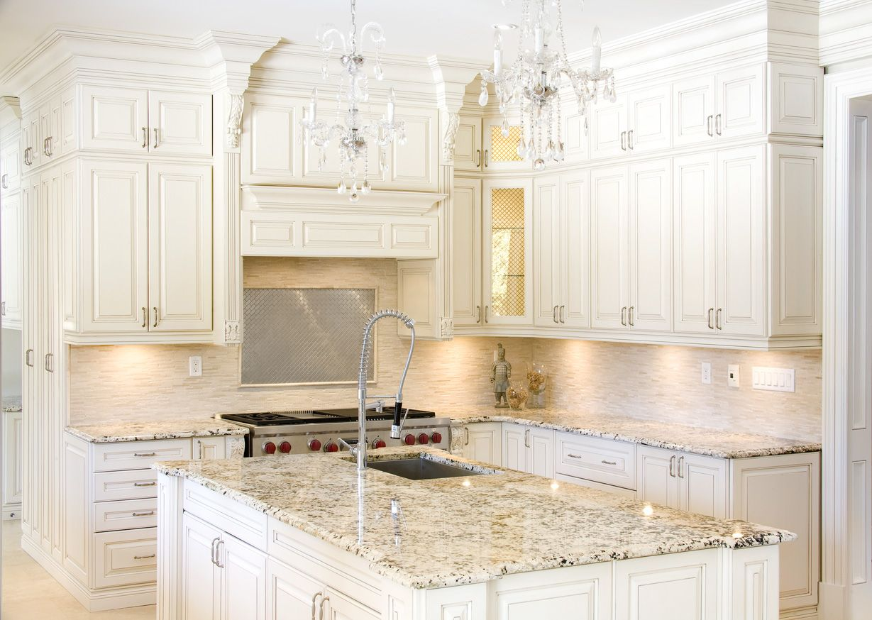 Elegant Kitchen With White Cabinets And White Ice Granite Countertops White Cabinets White Countertops Cheap Granite Countertops White Granite Countertops