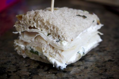 Barefoot Contessa's Tea Sandwiches-A raisin nut bread slathered with a cream cheese mixture (cream cheese, fresh basil and green onions all pureed) and a layer of thin deli turkey meat.