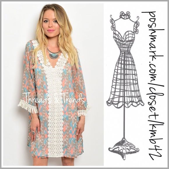 Salmon & Mint Print Tunic Dress Beautiful colors of salmon, mint and beige print tunic dress. Featuring crochet lace detail and tassel detail on sleeves. Size S/M, M/L made of a sheer chiffon. Pair with a lace extender for a finished look. Lace extender sold separately. Threads & Trends Dresses