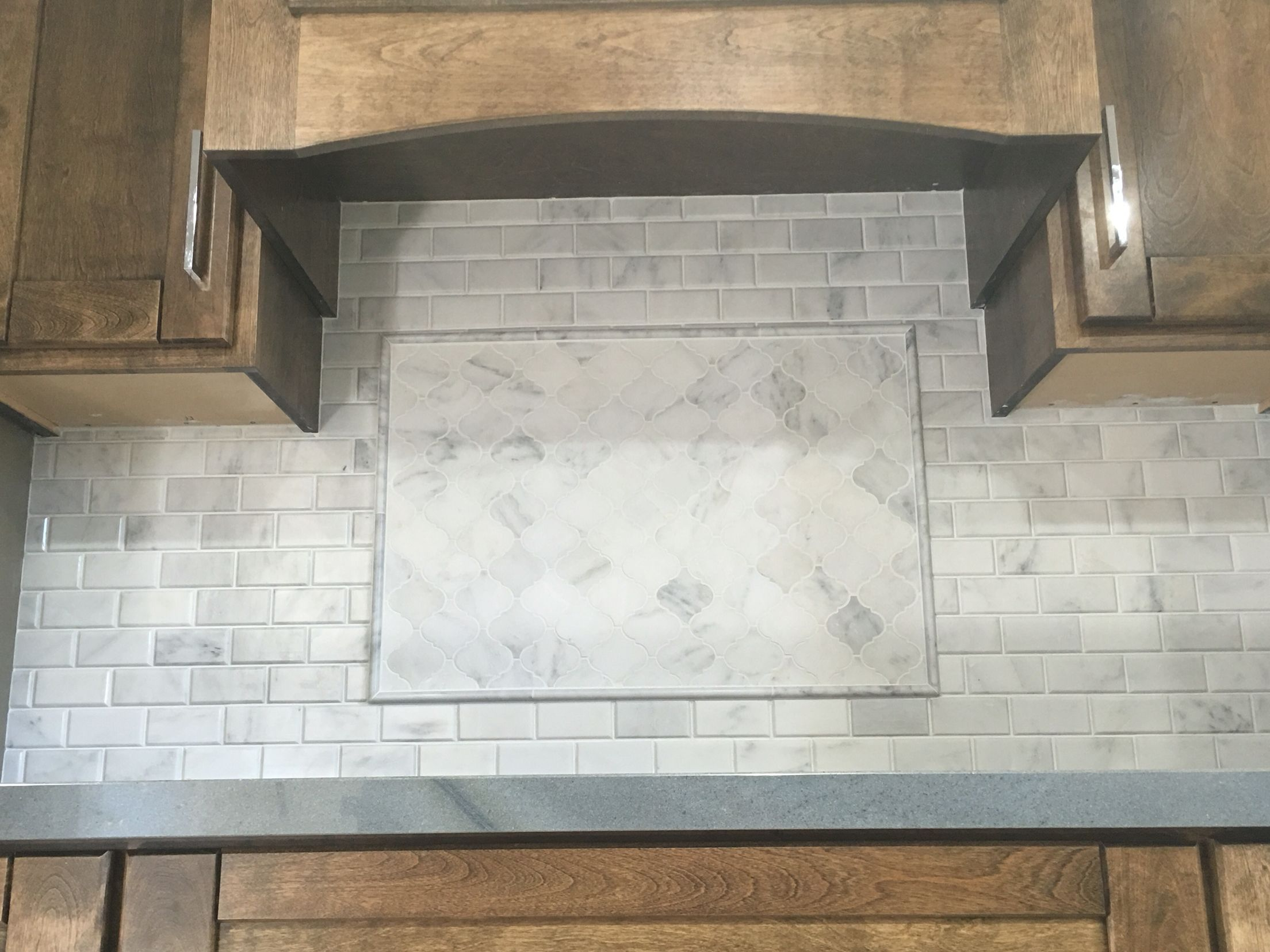 Kitchen backsplash Carrera subway tile Arabesque lantern mosaic