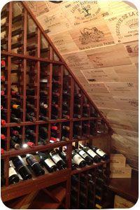 small walkinwine room with curved corner wine racks