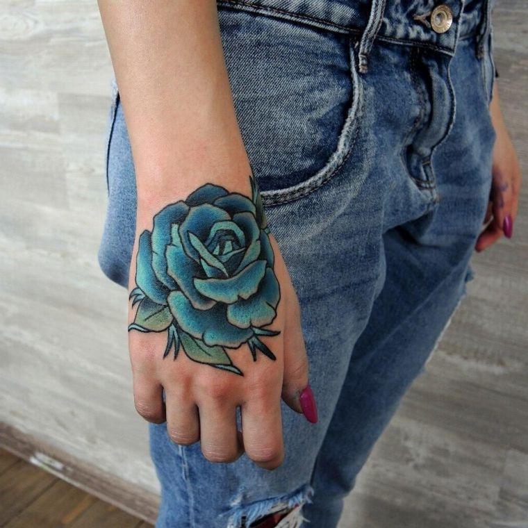 bellissima idea per un tatuaggio sulla mano, una rosa blu ...