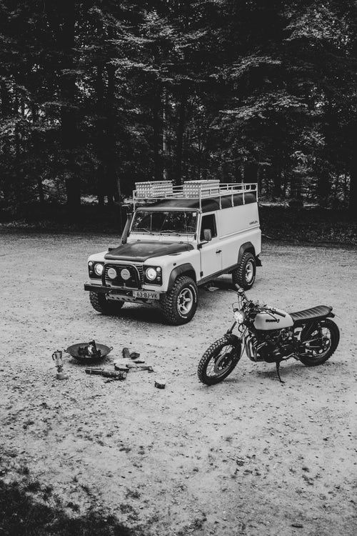 Grayscale Photography Of Suv And Motorcycle Monster Trucks