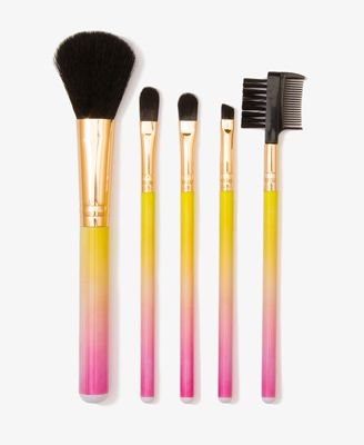88eb7377013 A cosmetic brush set featuring ombré handles. Includes a blush brush, three  shadow brushes, and one brow/lash comb. High polish metal trim.